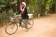 15 MARCH 2006 - CHONG KOH, KANDAL, CAMBODIA: A woman on a bike in Chong Koh, a village on the Mekong River in central Cambodia.  Photo by Jack Kurtz / ZUMA Press