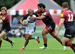 Bath centre Jonathan Joseph looks to get past Saracens flanker Billy Vunipola - Photo mandatory by-line: Patrick Khachfe/JMP - Tel: Mobile: 07966 386802 - 22/09/2013 - SPORT - RUGBY UNION - Allianz Park, London- Saracens v Bath Rugby - Aviva Premiership.