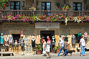 Tourists and locals in Calle de los Arzobispos in historic centre of Comillas, Cantabria, Northern Spain