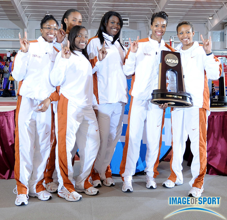 Mar 15, 2008; Fayetteville, AR, USA; The Texas women pose with team trophy after placing fourth with 35 points the NCAA indoor track and field championships at the Randal Tyson Center. From left: Katara Rosby, Bianca Knight, Jordyn Brown, Alexandria Anderson and Temeka Kincy.