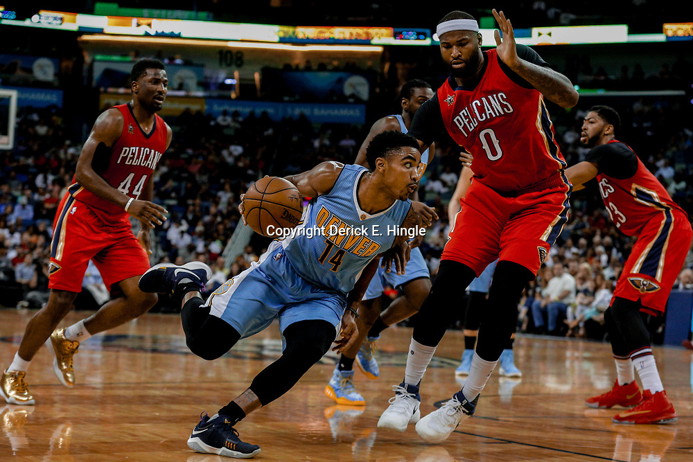 Apr 4, 2017; New Orleans, LA, USA; Denver Nuggets guard Gary Harris (14) drives past New Orleans Pelicans forward DeMarcus Cousins (0) during the second quarter of a game at the Smoothie King Center. Mandatory Credit: Derick E. Hingle-USA TODAY Sports