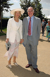 Leader of the Conservative party MICHAEL HOWARD and his wife SANDRA at the 4th day of the annual Glorious Goodwood horseracing festival held at Goodwood Racecourse, West Sussex on 30th July 2004.