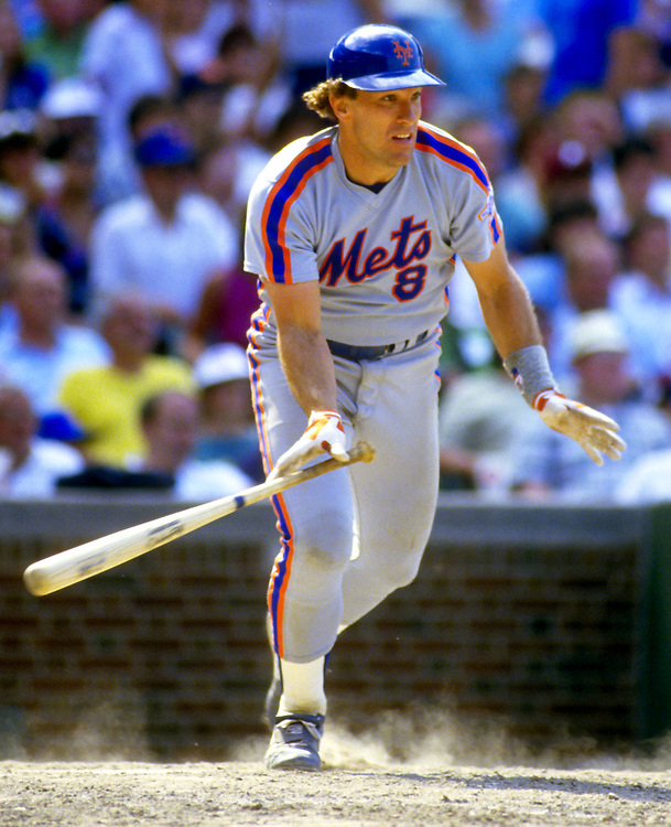 CHICAGO - 1986:  Gary Carter of the New York Mets bats during an MLB game against the Chicago Cubs at Wrigley Field in Chicago, Illinois.  Carter played for the Mets from 1985-1989.  (Photo by Ron Vesely)