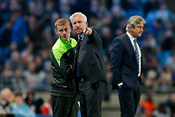 Newcastle United Manager Alan Pardew points something out to the 4th official after James Milner of Manchester City (not pictured) struggled to take a corner when a Newcastle United player tied his laces in his path - Photo mandatory by-line: Rogan Thomson/JMP - 07966 386802 - 29/10/2014 - SPORT - FOOTBALL - Manchester, England - Etihad Stadium - Manchester City v Newcastle United - Capital One Cup Fourth Round.