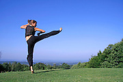 lateral jump kick - attractive young woman practicing self defense