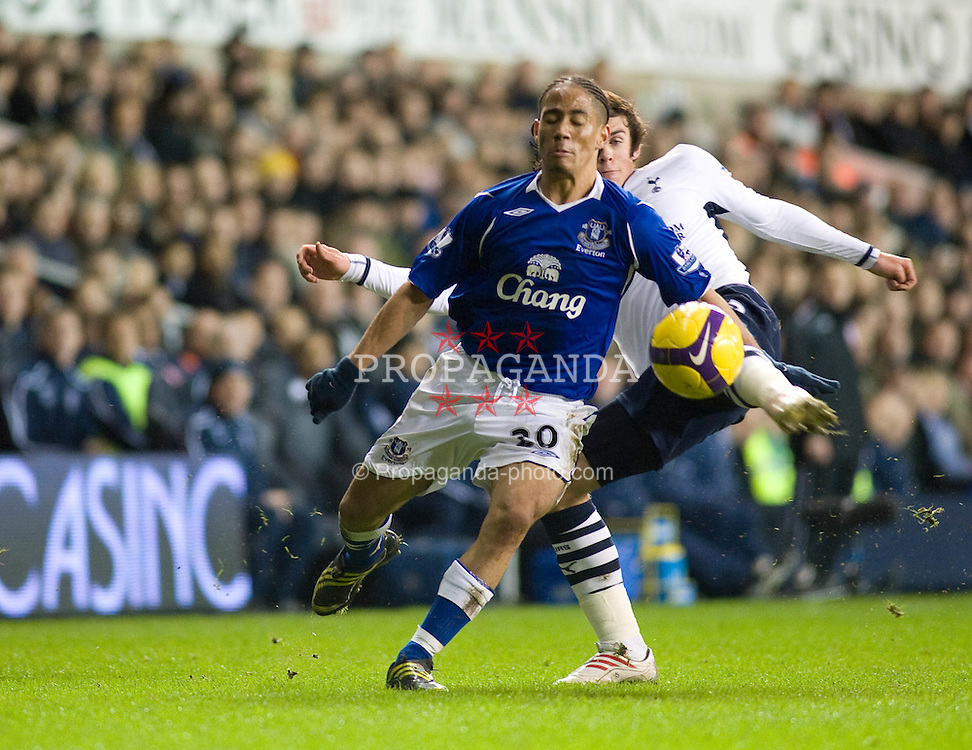 LONDON, ENGLAND - Sunday, November 30, 2008: Everton's Steven Pienaar is tackled by Tottenham Hotspur's Gareth Bale during the Premiership match at White Hart Lane. (Photo by Gareth Davies/Propaganda)
