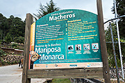 Sign at the entrance to the Cerro Pelon Monarch Butterfly Preserve near Macheros, Michoacan, Mexico. The monarch butterfly migration is a phenomenon across North America, where the butterflies migrates each autumn to overwintering sites in Central Mexico.