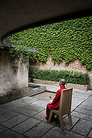 "VENICE, ITALY - 10 MAY 2017: A visitor participates in Lee Mingwei's ""When Beauty Visits"", an ongoing participatory performance with chair and costume, in the Central Pavillon of the 57th Internationl Art Exhibition in Venice, Italy, on May 10th 2017.<br /> <br /> The 57th International Art Exhibition, titled VIVA ARTE VIVA and curated by Christine Macel, is organized by La Biennale di Venezia chaired by Paolo Baratta. ""Viva Arte Viva is an exclamation, a passionate outcry for art and the state of the artist. Viva Arte Viva is a Biennale designed with artists, by artists and for artists, about the forms they propose, the questions they ask, the practices they develop and the ways of life they choose"", Christine Macel says. <br />  <br /> Rather than broaching a single theme, Viva Arte Viva offers a route that moulds the artists' works and a context that favours access and understanding, generating connections, resonances and thoughts. VIVA ARTE VIVA will unfold over the course of nine chapters or families of artists, beginning with two introductory realms in the Central Pavilion, followed by another seven across the Arsenale through the Giardino delle Vergini. 120 are the invited artists from 51 countries; 103 of these are participating for the first time. <br /> <br /> The Exhibition will also include 85 National Participations in the historic Pavilions at the Giardini, at the Arsenale and in the historic city centre of Venice. 3 countries will be participating for the first time: Antigua and Barbuda, Kiribati, Nigeria."
