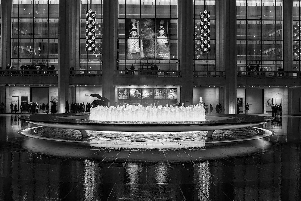 Crowds outside the David H. Koch Theater at Lincoln Center. seen from across the fountain in the Josie Robertson Plaza.