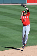 MESA, AZ - MARCH 09:  Zack Cozart #2 of the Cincinnati Reds jumps to make the out against the Oakland Athletics during the fourth inning in the spring training game at HoHoKam Stadium on March 9, 2017 in Mesa, Arizona.  (Photo by Jennifer Stewart/Getty Images)