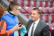 A relaxed Brendan Rodgers chats to a fan before the Ladbrokes Scottish Premiership match between Heart of Midlothian and Celtic at Tynecastle Stadium, Gorgie, Scotland on 17 December 2017. Photo by Kevin Murray.