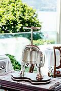 """Bellagio, Italy, Ristorante Mistral, at Villa Serbelloni Hotel, chef Ettore Bocchia. a silver machine for the """"canard à la presse"""""""