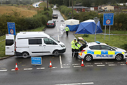 © Licensed to London News Pictures. 16/08/2019. Sulhamstead, UK. The scene at the junction of the A4 and Ufton Lane near Sulhamstead, Berkshire, where a police officer was killed while investigating a suspected burglary. Ten people have been arrested on suspicion of murder including a 13-year-old child. Photo credit: Peter Macdiarmid/LNP