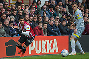 Said Benrahma (Brentford) with Tom Lawrence (Derby County) looking on during the EFL Sky Bet Championship match between Brentford and Derby County at Griffin Park, London, England on 6 April 2019.
