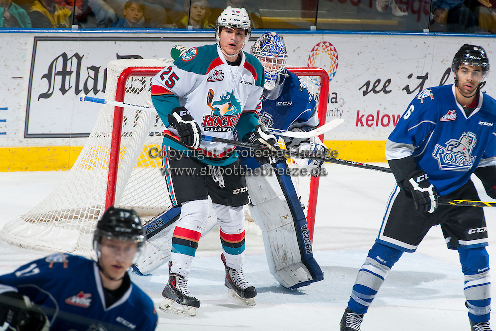 KELOWNA, CANADA - MARCH 11: Alex Uryga #25 of the Kelowna Rockets stands in front of the net of Coleman Vollrath #35 of Victoria Royals on March 11, 2015 at Prospera Place in Kelowna, British Columbia, Canada.  (Photo by Marissa Baecker/Shoot the Breeze)  *** Local Caption *** Alex Uryga; Coleman Vollrath;