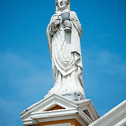 Statue of Saint John that sits atop the Iglesia de Xalteva. The Barque styled Iglesia de Xalteva, in the western part of Granada, was originally built in the 19th century, but it has been destroyed and rebuilt several times since, most recently in 1921.