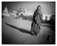 Monk in morning sun, Labrang Monastery, Amdo, Tibet.