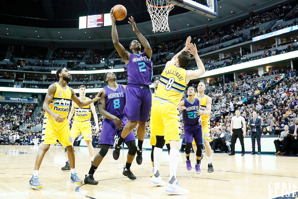 04 March 2017: Charlotte Hornets forward Marvin Williams (2) goes for the layup over Denver Nuggets forward Danilo Gallinari (8) during the Charlotte Hornets 112-102 victory over the Denver Nuggets, at the Pepsi Center, Denver, Colorado, USA.