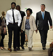 Karsiah Duncan (L), the son of Ebola patient Thomas Eric Duncan, walks out for a press conference at at Wilshire Baptist Church on October 7, 2014, in Dallas. (Cooper Neill for The New York Times)