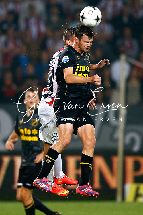 Onderwerp/Subject: Willem II - NAC Breda - Eredivisie<br /> Reklame:  <br /> Club/Team/Country: <br /> Seizoen/Season: 2014/2015<br /> FOTO/PHOTO: Stijn WUYTENS (L) of Willem II in duel with Erik FALKENBURG (L) of NAC Breda. (Photo by PICS UNITED)<br /> <br /> Trefwoorden/Keywords: <br /> #04 $94 &plusmn;1401920268162<br /> Photo- &amp; Copyrights &copy; PICS UNITED <br /> P.O. Box 7164 - 5605 BE  EINDHOVEN (THE NETHERLANDS) <br /> Phone +31 (0)40 296 28 00 <br /> Fax +31 (0) 40 248 47 43 <br /> http://www.pics-united.com <br /> e-mail : sales@pics-united.com (If you would like to raise any issues regarding any aspects of products / service of PICS UNITED) or <br /> e-mail : sales@pics-united.com   <br /> <br /> ATTENTIE: <br /> Publicatie ook bij aanbieding door derden is slechts toegestaan na verkregen toestemming van Pics United. <br /> VOLLEDIGE NAAMSVERMELDING IS VERPLICHT! (&copy; PICS UNITED/Naam Fotograaf, zie veld 4 van de bestandsinfo 'credits') <br /> ATTENTION:  <br /> &copy; Pics United. Reproduction/publication of this photo by any parties is only permitted after authorisation is sought and obtained from  PICS UNITED- THE NETHERLANDS