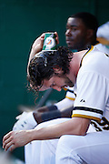 PITTSBURGH, PA - JUNE 30: Jason Grilli #39 of the Pittsburgh Pirates pours water over his head as he sits on the bench against the Milwaukee Brewers during the game at PNC Park on June 30, 2013 in Pittsburgh, Pennsylvania. The Pirates won 2-1 in 14 innings. (Photo by Joe Robbins)  Jason Grilli