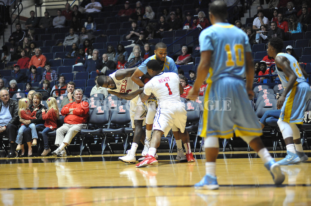 """Ole Miss' forward M.J. Rhett (4) and Ole Miss' guard Martavious Newby (1) tie up southern University Jaguars center Frank Snow (22) at the C.M. """"Tad"""" Smith Coliseum in Oxford, Miss. on Thursday, November 20, 2014. (AP Photo/Oxford Eagle, Bruce Newman)"""