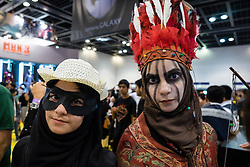Dubai, April 4th 2014; Fans in costume at the 2014 Middle East Film and Comic Con at World Trade Centre in Dubai United Arab Emirates