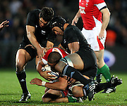 Dan Carter and Victor Vito tackle Welsh flanker Gavin Thomas.<br /> Steinlager Series international test match rugby - All Blacks v Wales at Carisbrook, Dunedin. Saturday 19 June 2010. Photo: Dave Lintott/PHOTOSPORT
