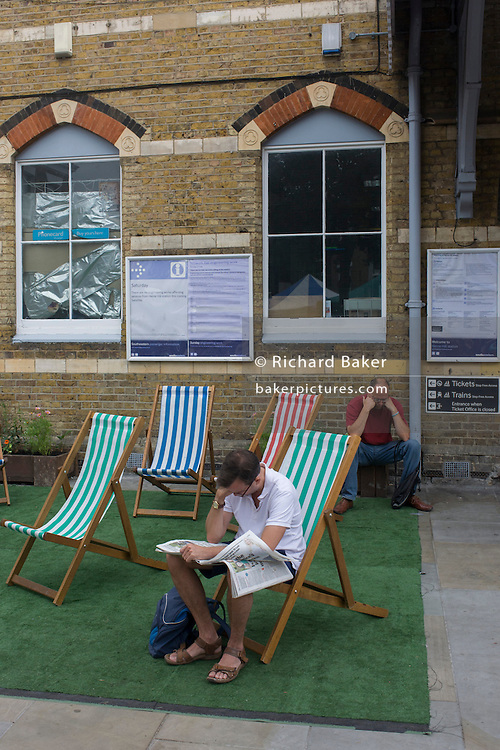 South Londoners enjoy deckchairs outside Herne Hill station during a summer heatwave.
