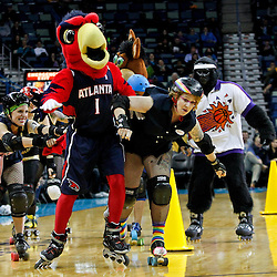 February 10, 2012; New Orleans, LA, USA; Big Easy Roller Girls attempt to knockdown the mascot for the Atlanta Hawks during a game of roller derby musical chairs during halftime of a game between the New Orleans Hornets and the Portland Trail Blazers at the New Orleans Arena. The Trail Blazers defeated the Hornets 94-86. Mandatory Credit: Derick E. Hingle-US PRESSWIRE
