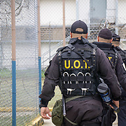 JULY 19, 2018----BAYAMON, PUERTO RICO---<br /> A tactical unit of three officers  walks around barbwire fences in the Bayamon Correctional Complex which is made up of four buildings. The Puerto Rico Corrections and Rehabilitation Department is in the middle of a project to downsize by transferring inmates to private jails in the United States and closing institutions like this.<br /> (Photo by Angel Valentin/Freelance)