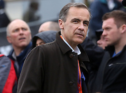 © Licenced to London News Pictures. 06/04/2014. London. UK.  <br /> Bank of England Govennor Mark Carney is pictured watching the Oxford and Cambridge University rowing eights battle it out against each other during the annual BNY Mellon Boat Race between the two crews on the River Thames in London, April 6th, 2014. <br /> Credit: Susannah Ireland