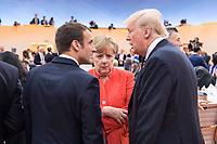 07 JUL 2017, HAMBURG/GERMANY:<br /> Emmanuel Macron (L), Praesident Frankreich, Angela Merkel (M), CDU, Bundeskanzlerin, und Donald Trump (R), Praesident Vereinigte Staatsn von America, USA, im Gesprech, vor Beginn der 1. Arbeitssitzung, G20 Gipfel, Messe<br /> IMAGE: 20170707-01-048<br /> KEYWORDS: G20 Summit, Deutschland, Gespr&auml;ch