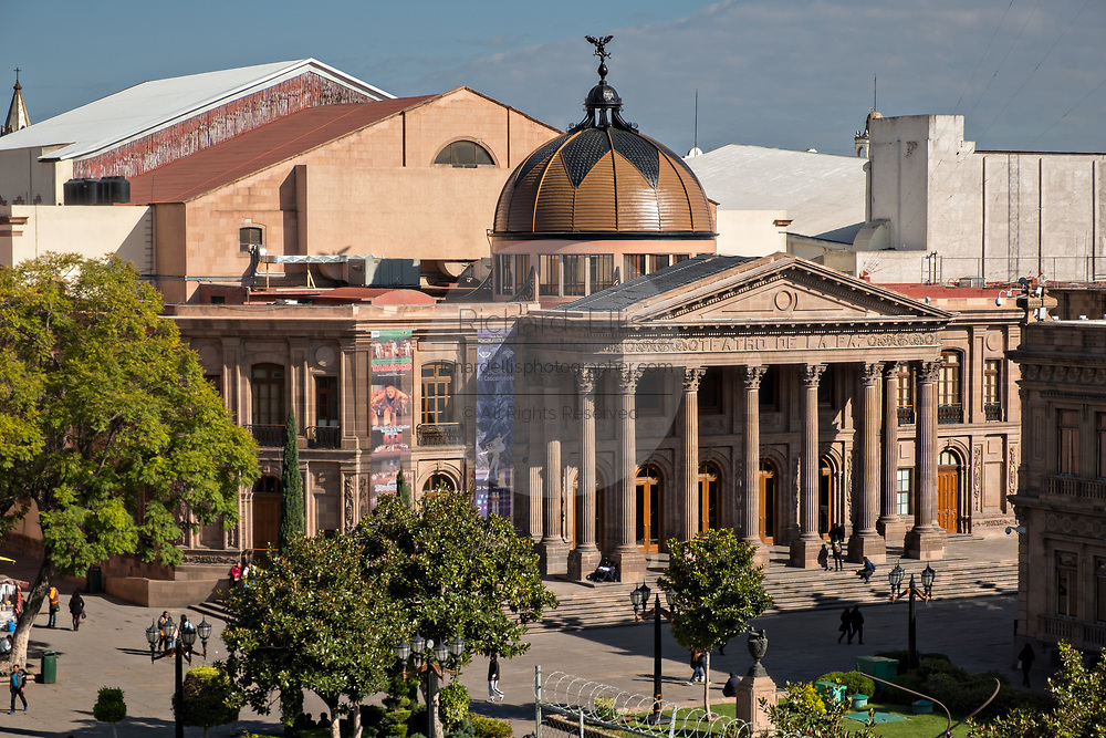 Elevated view of the Teatro de la Paz or Theater of Peace in the historic center on the Plaza del Carmen in the state capital of San Luis Potosi, Mexico. The building was built by the architect Jose Noriega with French influences and neoclassical style, with its facade in pink quarry in 1894.