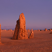 Australia, Western Australia, Nambung National Park, Early morning sun lights limestone pinnacles in desert near town of Cervantes