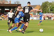 Toyosi Olusanya striker for AFC Wimbledon (35) is fouled in the box during the Sky Bet League 2 match between AFC Wimbledon and Newport County at the Cherry Red Records Stadium, Kingston, England on 7 May 2016. Photo by Stuart Butcher.