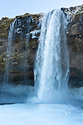 Spectacular waterfall Seljalandsfoss in South Iceland with gushing glacial melting waters from Eyjafjahajokul icecap