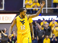 Jan 24, 2017; Morgantown, WV, USA; West Virginia Mountaineers guard Tarik Phillip (12) pumps up the crowd during the second half against the Kansas Jayhawks at WVU Coliseum. Mandatory Credit: Ben Queen-USA TODAY Sports