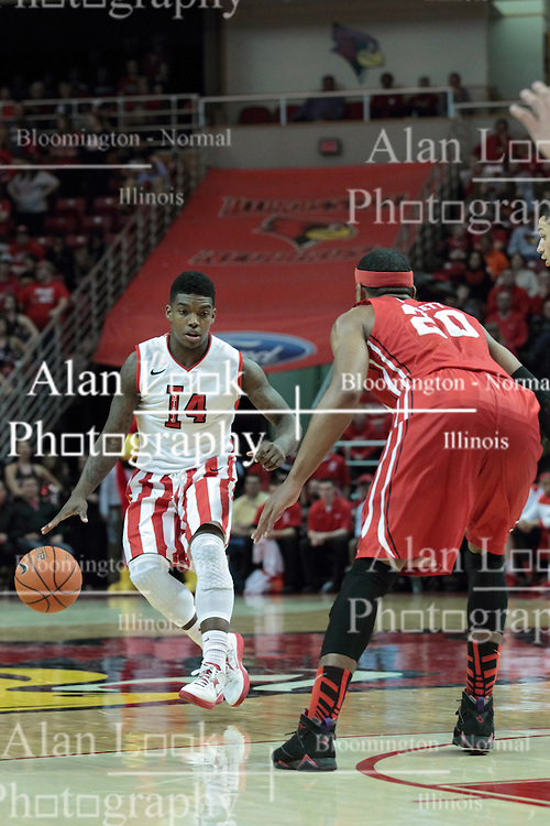 15 February 2014:  Bobby Hunter looks at the feet of Tyshon Pickett as he nears the three point line during an NCAA Missouri Valley Conference (MVC) mens basketball game between the Bradley Braves and the Illinois State Redbirds  in Redbird Arena, Normal IL.