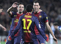 06.01.2013 Barcelona, Spain. La Liga day 18. Pedro, Xavi and Sergio after scoring during game between FC Barcelona against RCD Espanyol at Camp Nou