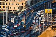 Long exposure of heavy afternoon traffic congestion on bridge crossing Nile River, Cairo, Egypt