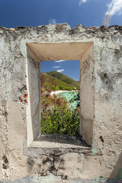 A peek at Lamesur Beach through the window opening of sugar mill ruins on St John, USVI.