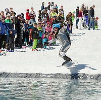 With a rabbit ready to pull out of his hat Chirs Long hits the water during Gunstock's annual B.Y.O.D.C. Pond Skim on Sunday afternoon.  (Karen Bobotas/for the Laconia Daily Sun)