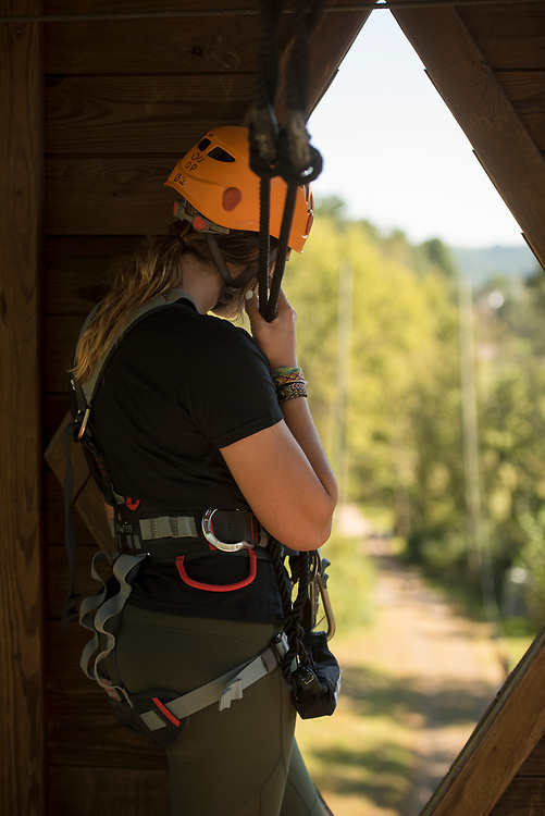 Megan Phelan stands by the window in the zipline tower. Photo by Hannah Ruhoff