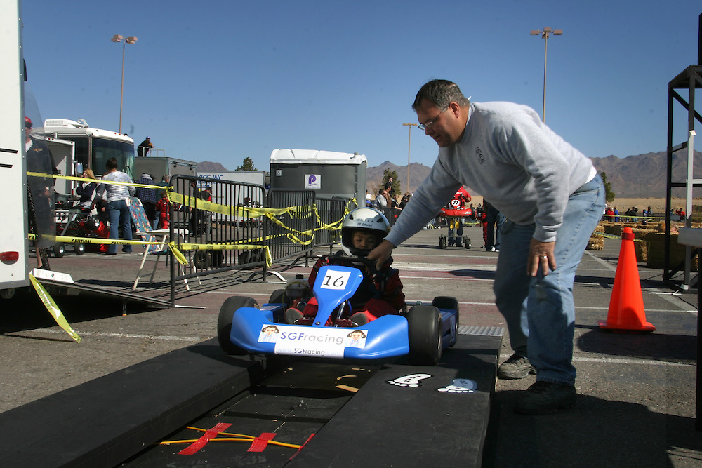 Chloe St. George 6  and her  father Kith taking the go kart to technical check after the race in Primm Nevada  on Saturday march 3 .2007.....