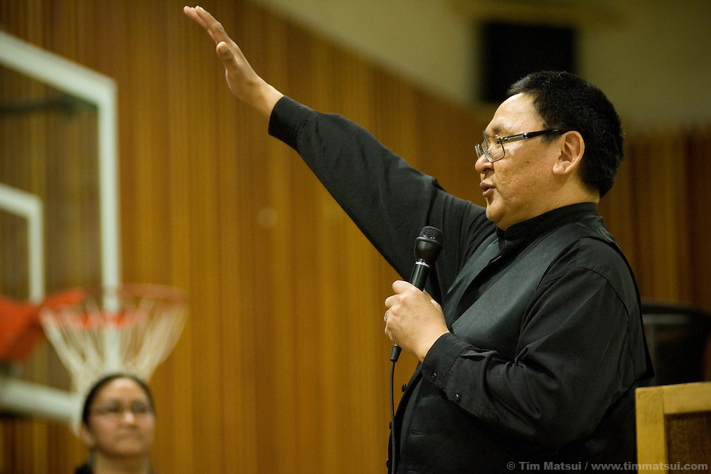 May 2, 2008 -- Kivalina, AK, U.S.A..Reverend Enoch Adams speaks to the three person graduating class of 2008 in the native village of Kivalina, Alaska. Kivalina is suing 20 oil companies for property damage related to global warming; the ocean pack ice forms later and melts earlier, leaving the town vulnerable to erosive winter storms and endangering their traditional subsistence lifestyle. (Photo by Tim Matsui)