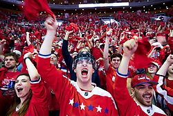 WASHINGTON, DC - JUNE 07: A Washington Capitals fans cheer during a fan watch party at Capitol One Area on June 7, 2018 in Washington, DC. The Washington Capitals defeated the the Las Vegas Golden Knights to capture their first Stanley Cup Championship.