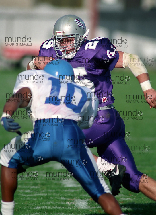 (October 1, 1994) University of Western Ontario Mustangs play the University of Toronto Varsity Blues in OUAA  football played at J W Little Stadium in London, Ontario. Photograph copyright Sean Burges / Mundo Sport Images.