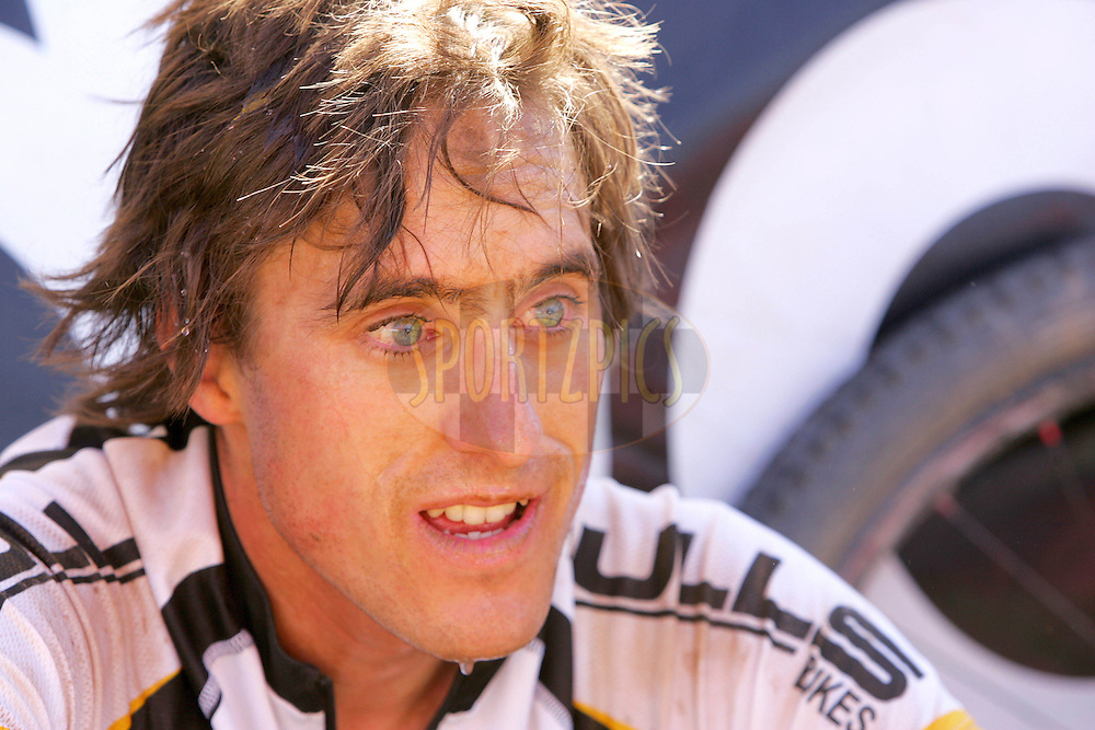 WESTERN CAPE, SOUTH AFRICA -  31 March 2008,Stefan Sahm of Team Bulls after finishing stage three of the 2008 Absa Cape Epic Mountain Bike stage race from Calitzdorp Spa.to Langenhoven High School in Riversdale, Western Cape, South Africa..Photo by Ron Gaunt/SPORTZPICS