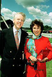 SIR CHARLES & LADY POWELL at a polo match in Cirencester on 6th July 1997.<br /> LZZ 70